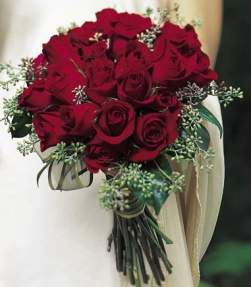Brides Bouquets Rich With Roses And Deep Red Stephanotis