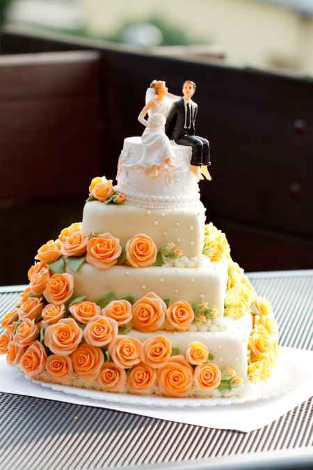 wedding cakes with orange flowers